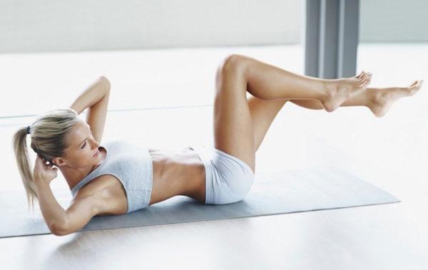 Боли внизу живота могут возникать из-за избыточных нагрузок, в том числе и при занятиях гимнастикой