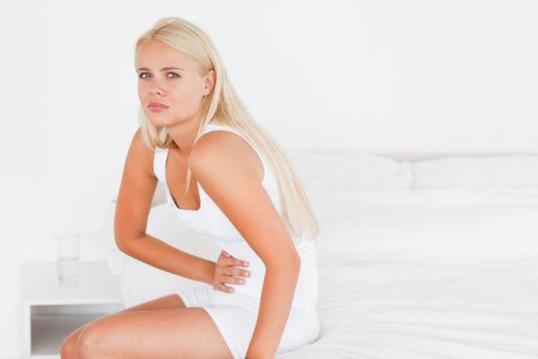 болит желудок и тошнит причины у женщин